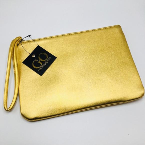 Cynthia Rowley Handbags - Cynthia Rowley 💛 gold Go bag wristlet case clutch
